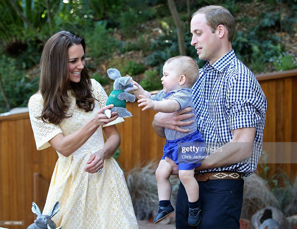 <a gi-track='captionPersonalityLinkClicked' href=/galleries/search?phrase=Prince+William&family=editorial&specificpeople=178205 ng-click='$event.stopPropagation()'>Prince William</a>, Duke of Cambridge holds <a gi-track='captionPersonalityLinkClicked' href=/galleries/search?phrase=Prince+George+of+Cambridge&family=editorial&specificpeople=11176510 ng-click='$event.stopPropagation()'>Prince George of Cambridge</a> as Catherine, Duchess of Cambridge gives him a toy bilby during a visit to the Bilby Enclosure at Taronga Zoo on April 20, 2014 in Sydney, Australia. The Duke and Duchess of Cambridge are on a three-week tour of Australia and New Zealand, the first official trip overseas with their son, <a gi-track='captionPersonalityLinkClicked' href=/galleries/search?phrase=Prince+George+of+Cambridge&family=editorial&specificpeople=11176510 ng-click='$event.stopPropagation()'>Prince George of Cambridge</a>.