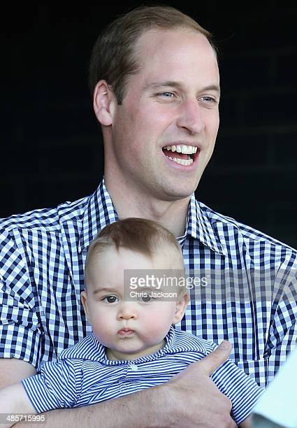 Prince William Duke of Cambridge holds Prince George of Cambridge as they look at a Bilby called George at Taronga Zoo on April 20 2014 in Sydney...
