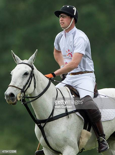 Prince William Duke of Cambridge in action during day two of the Audi Polo Challenge at Coworth Park on May 31 2015 in London England