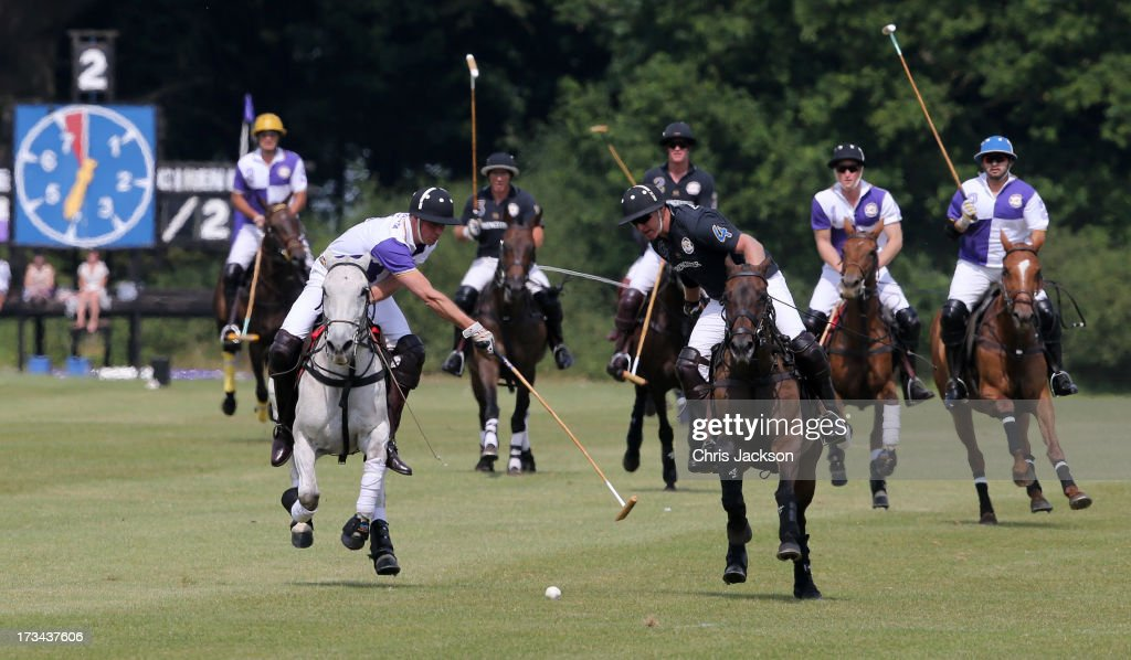 <a gi-track='captionPersonalityLinkClicked' href=/galleries/search?phrase=Prince+William&family=editorial&specificpeople=178205 ng-click='$event.stopPropagation()'>Prince William</a>, Duke of Cambridge (2nd L) in action the Jerudong Trophy at Cirencester Park Polo Club on July 14, 2013 in Cirencester, England.