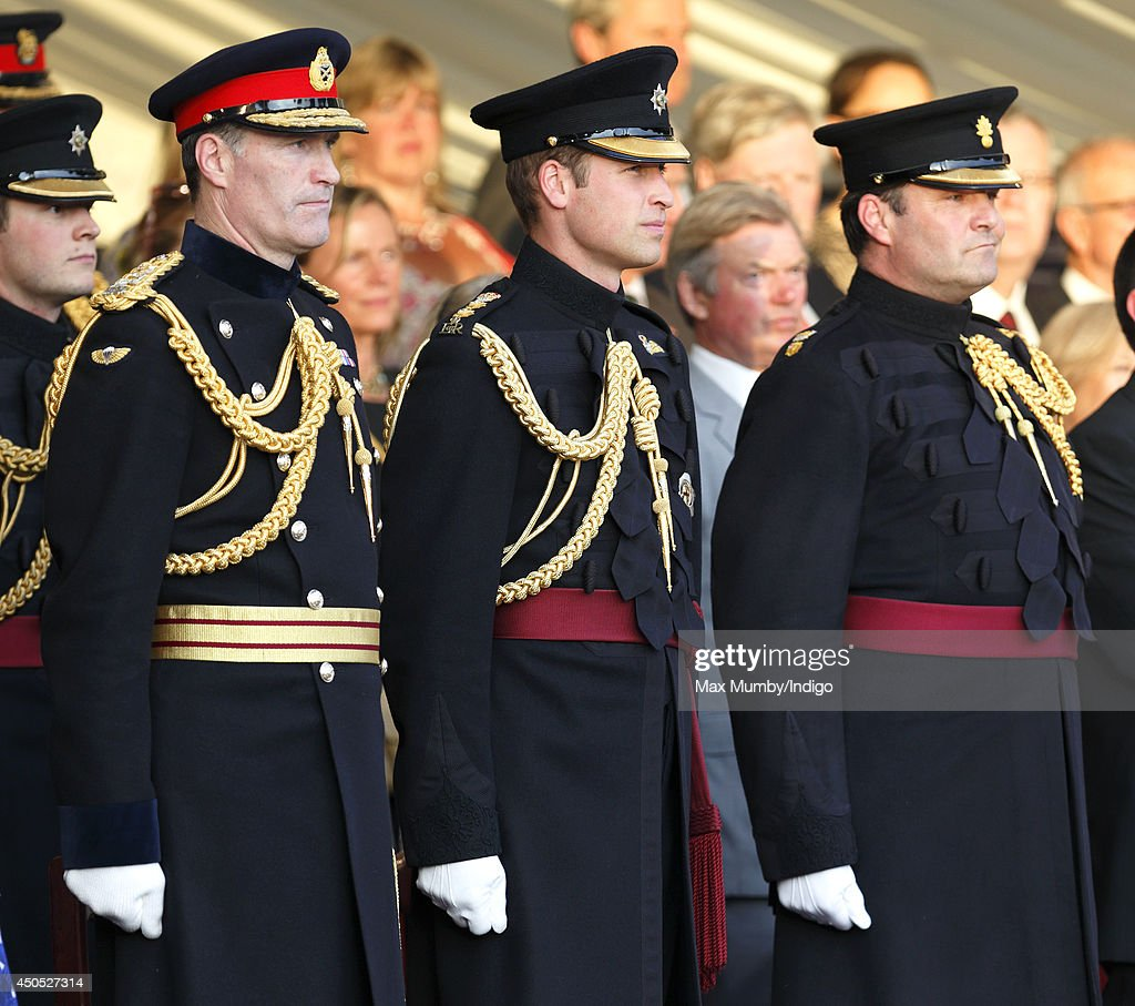 Prince William, Duke of Cambridge (centre), in his role as Colonel of the Irish Guards, attends the Household Division's Beating Retreat on Horse Guards Parade on June 12, 2014 in London, England.
