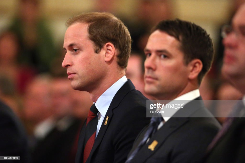 Prince William, Duke of Cambridge, in his role as President of The Football Association, sits with former England footballer Michael Owen in the Ballroom of Buckingham Palace at an event to honour The FA's 150 Grassroots Heroes on October 7, 2013 in London, England. 150 volunteers who work to support grassroots football. were presented with a medal by The Duke of Cambridge and Greg Dyke, the Charmian of the Football Association. To celebrate 150 years of the FA, an official Southern Amateur League fixture football match will take place in the grounds of Buckingham Palace between two of the oldest amateur clubs in England. The match will be played between Civil Service FC, the sole surviving club from the eleven that met to create The FA in 1863, and Polytechnic FC, which was formed in 1875.
