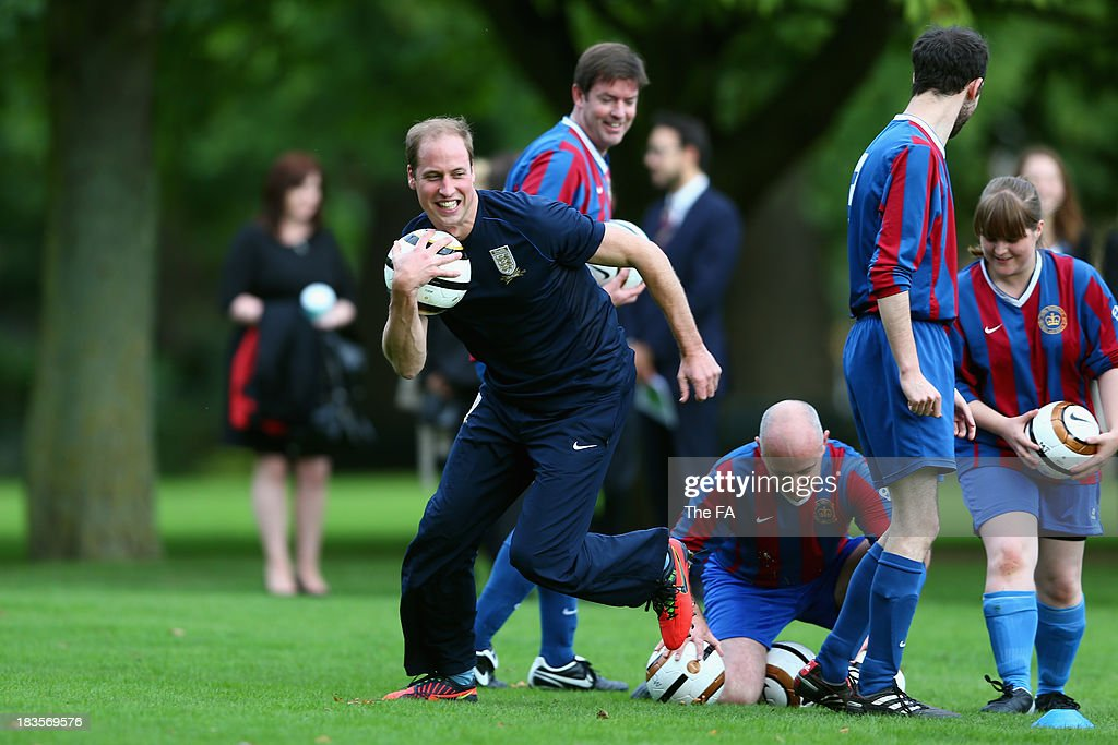 Prince William, Duke of Cambridge in his role as The President of The Football Association attends a coaching session during the first ever football match at Buckingham Palace between Civil Service FC and Polytechnic FC as part of The FA's 150th anniversary and an awards ceremony celebrating football's grassroots heroes at Buckingham Palace on October 7, 2013 in London, England.