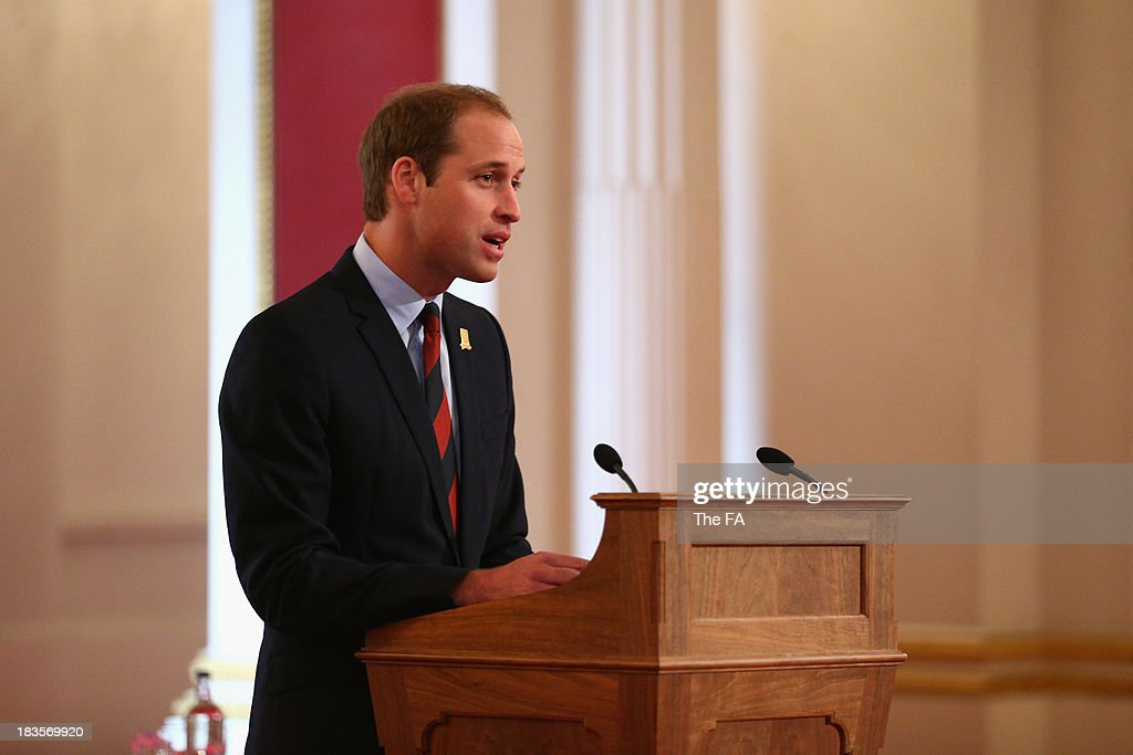 Prince William, Duke of Cambridge in his role as The President of The Football Association speaks before awarding medals to 150 grassroots heroes for their outstanding contribution and service to football. The Ceremony at Buckingham Palace took place as part of The FA's 150th anniversary at Buckingham Palace on October 7, 2013 in London, England.