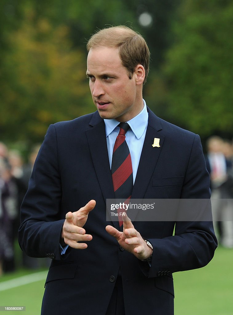 Prince William, Duke of Cambridge in his role as The President of The Football Association attends the first ever football match at Buckingham Palace between Civil Service FC and Polytechnic FC as part of The FA's 150th anniversary and an awards ceremony celebrating football's grassroots heroes at Buckingham Palace on October 7, 2013 in London, England.