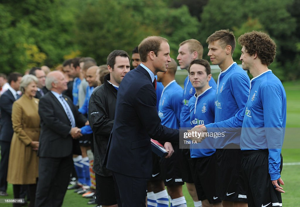 Prince William, Duke of Cambridge in his role as The President of The Football Association meets the teams before the first ever football match at Buckingham Palace between Civil Service FC and Polytechnic FC as part of The FA's 150th anniversary and an awards ceremony celebrating football's grassroots heroes at Buckingham Palace on October 7, 2013 in London, England.