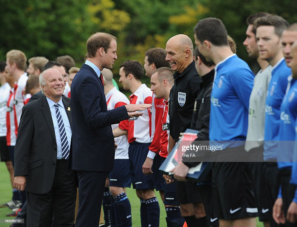 Prince William, Duke of Cambridge in his role as The President of The Football Association meets referee Howard Webb before the first ever football match at Buckingham Palace between Civil Service FC and Polytechnic FC as part of The FA's 150th anniversary and an awards ceremony celebrating football's grassroots heroes at Buckingham Palace on October 7, 2013 in London, England.