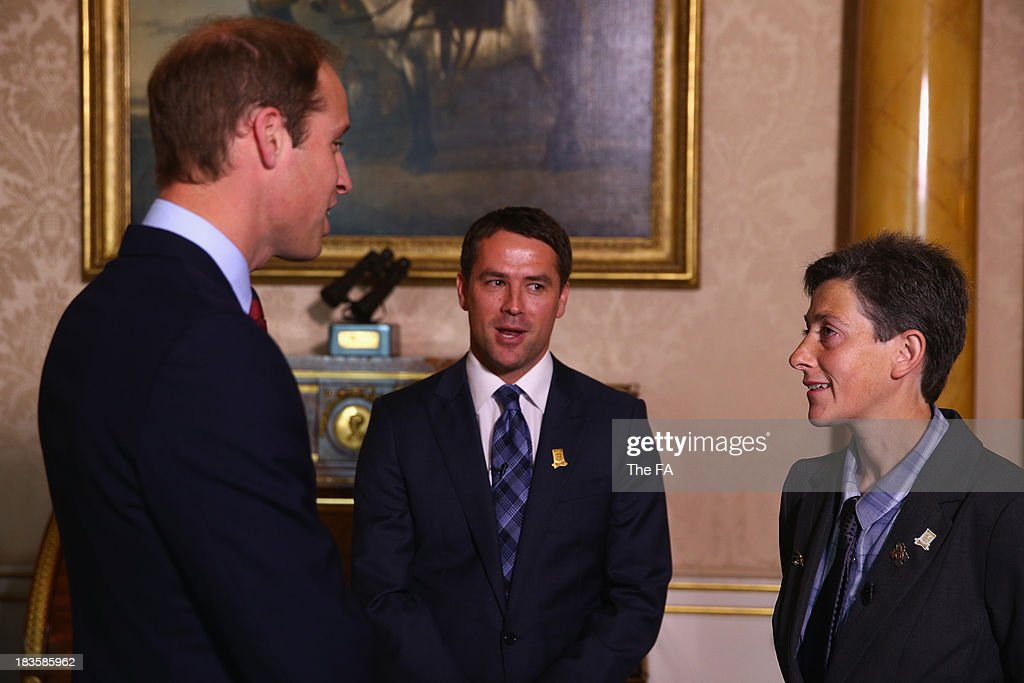 Prince William, Duke of Cambridge, in his role as The President of The Football Association accompanied by Michael Owen meets Pride of Britain winner Ms June Kelly during the first ever football match at Buckingham Palace between Civil Service FC and Polytechnic FC as part of The FA's 150th anniversary and an awards ceremony celebrating football's grassroots heroes at Buckingham Palace on October 7, 2013 in London, England.