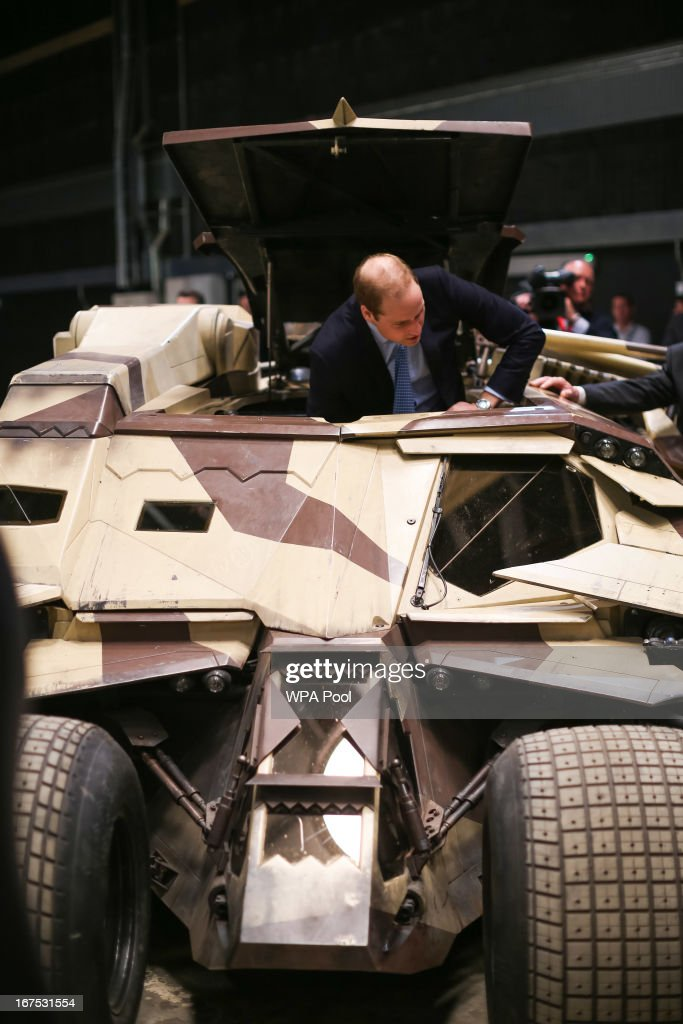 Prince William, Duke of Cambridge inspects the 'Tumbler', a vehicle used in the Batman films during the Inauguration Of Warner Bros. Studios Leavesden on April 26, 2013 in London, England.
