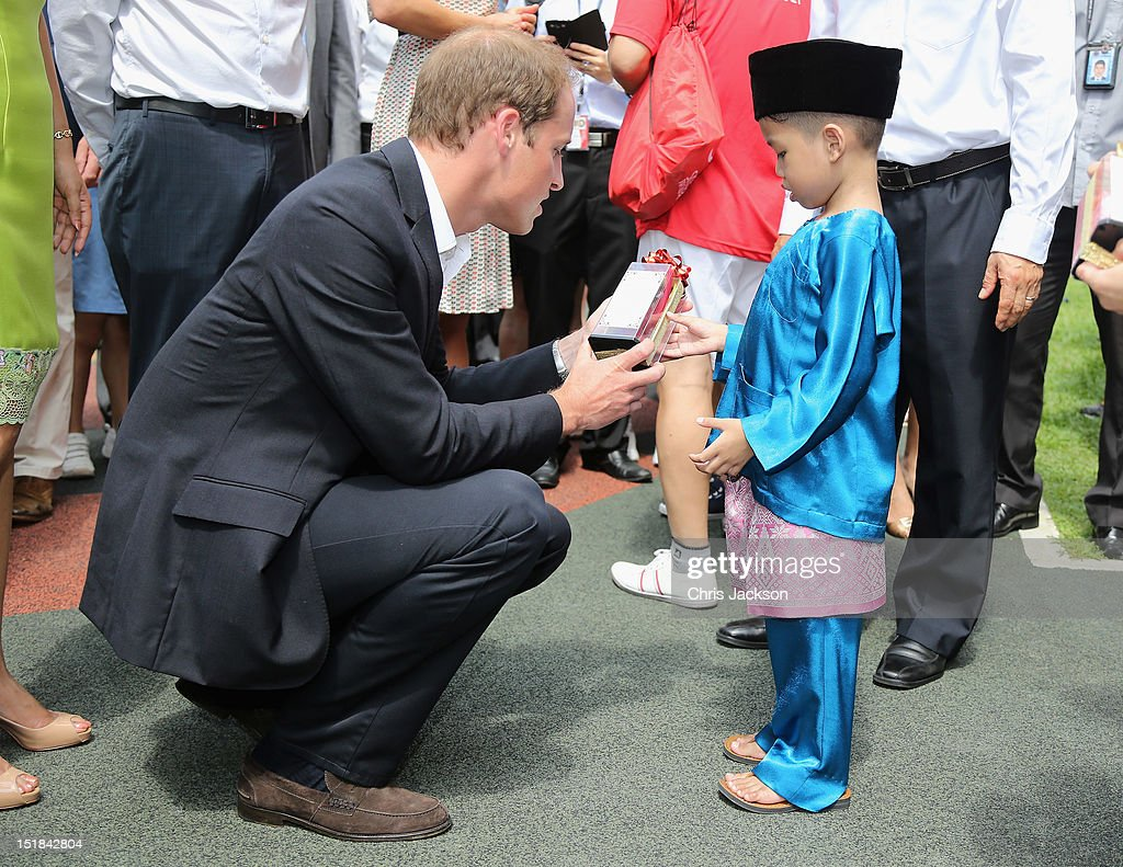 <a gi-track='captionPersonalityLinkClicked' href=/galleries/search?phrase=Prince+William&family=editorial&specificpeople=178205 ng-click='$event.stopPropagation()'>Prince William</a>, Duke of Cambridge is given a gift as he attends a cultural event in Queenstown on day 2 of <a gi-track='captionPersonalityLinkClicked' href=/galleries/search?phrase=Prince+William&family=editorial&specificpeople=178205 ng-click='$event.stopPropagation()'>Prince William</a>, Duke of Cambridge and Catherine, Duchess of Cambridge's Diamond Jubilee Tour of the Far East on September 12, 2012 in Singapore. <a gi-track='captionPersonalityLinkClicked' href=/galleries/search?phrase=Prince+William&family=editorial&specificpeople=178205 ng-click='$event.stopPropagation()'>Prince William</a>, Duke of Cambridge and Catherine, Duchess of Cambridge are on a Diamond Jubilee Tour of the Far East taking in Singapore, Malaysia, the Solomon Islands and the tiny Pacific Island of Tuvalu.