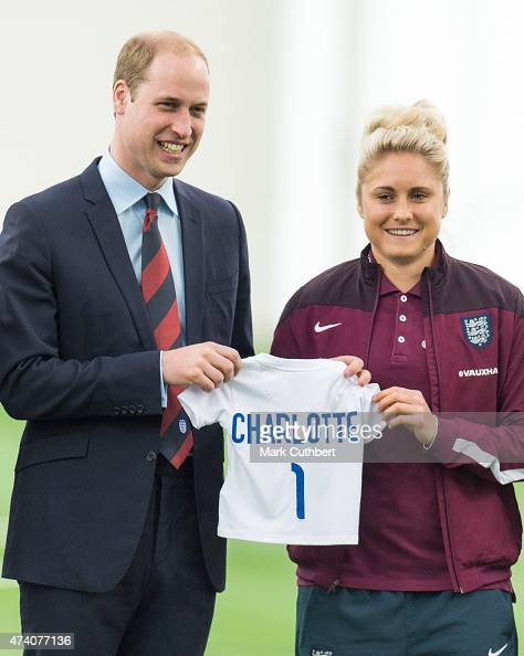 Prince William Duke of Cambridge is given an England shirt for Princess Charlotte by England Captain Steph Houghton during a visit to meet the...