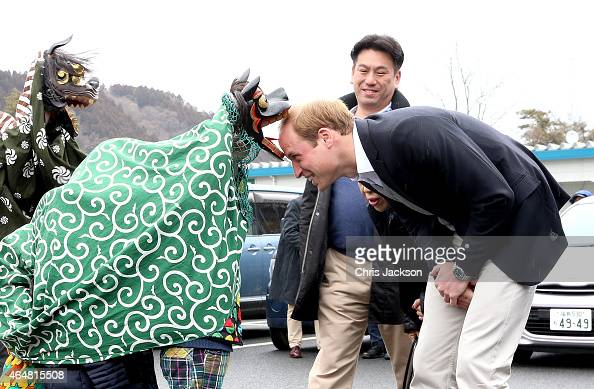 Prince William Duke of Cambridge is greeted by Lion Dancers performing in an Shishimai Ceremony at Chime of Hope Shopping Centre on March 1 2015 in...