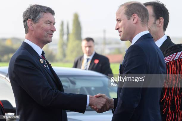 Prince William Duke of Cambridge is greeted by Vice Admiral Sir Timothy Laurence at the New Zealand Memorial Wall to the Missing during the...