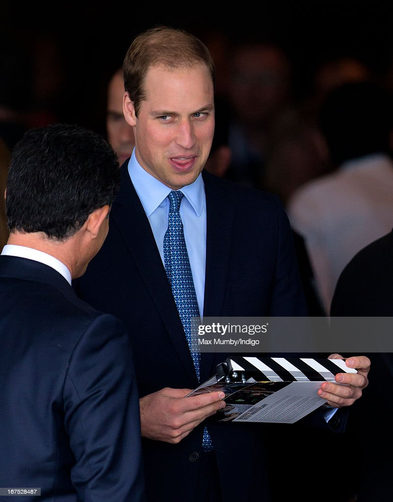 Prince William, Duke of Cambridge is presented with a clapper board as he attends the Inauguration of Warner Bros. Studios Leavesden on April 26, 2013 in London, England.