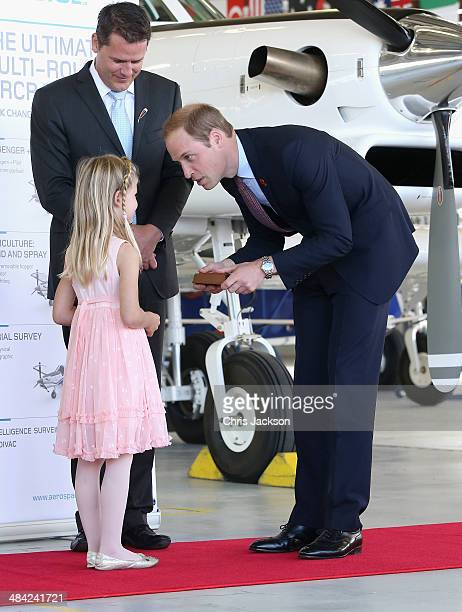 Prince William Duke of Cambridge is presented with a gift as he visits Pacific Aerospace on April 12 2014 in Hamilton New Zealand The Duke and...