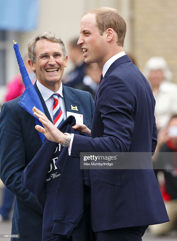 Prince William, Duke of Cambridge is presented with a hoodie emblazoned with 'The Duchess of Cambridge' as he and Prince Harry attend the opening of the new Help for Heroes Recovery Centre at Tedworth House on May 20, 2013 in Tidworth, England. During their visit the two Royal Princes met with wounded veterans, serving personnel, and their families. Tedworth House in Wiltshire is one of four new units in England which will offer respite care and rehabilitation to injured and sick service personnel, veterans and their families.