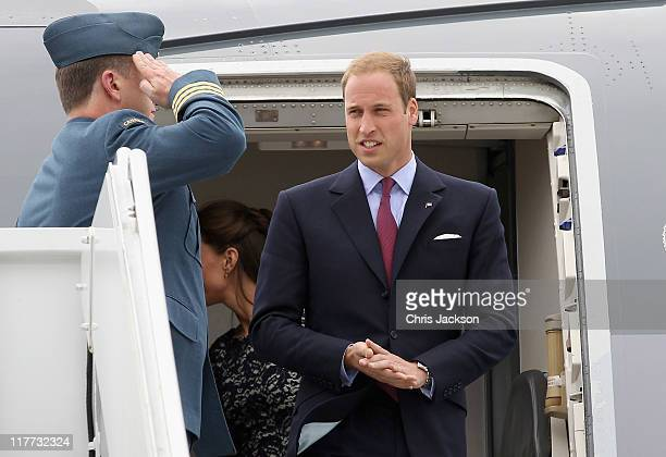 Prince William Duke of Cambridge is saluted as he arrives at MacdonaldCartier International Airport on June 30 2011 in Ottawa Canada The newly...