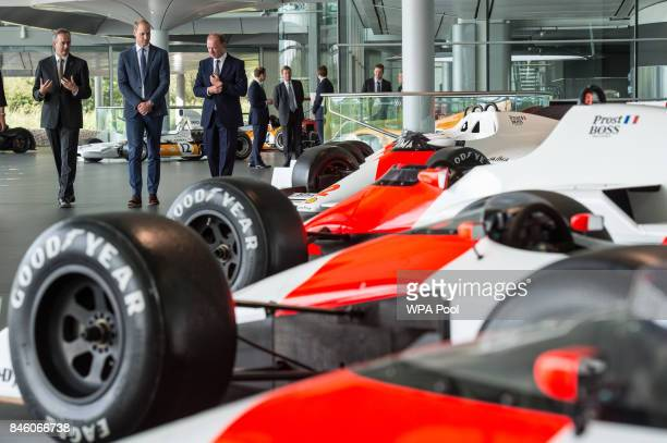 Prince William Duke of Cambridge is shown Formula One racing cars previously used by Alain Prost and Ayrton Senna in the McLaren Technology Centre by...