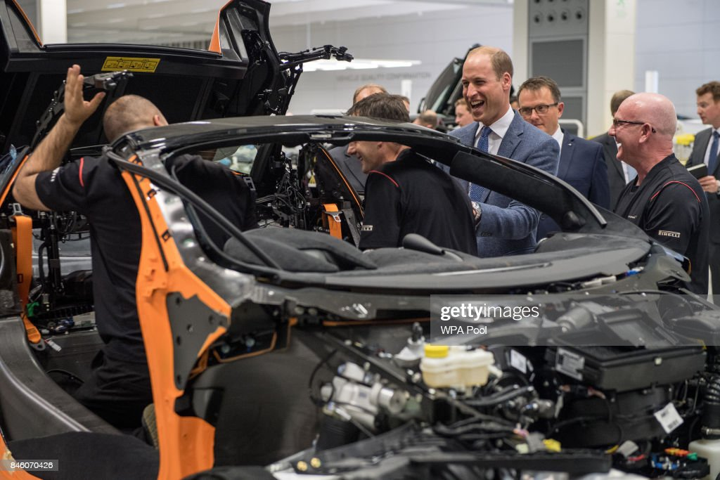 Prince William, Duke of Cambridge (centre right) jokes with employees on the McLaren commercial vehicle production line as he walks the factory floor during a visit to McLaren Automotive at McLaren Technology Centre on September 12, 2017 in Woking, England.