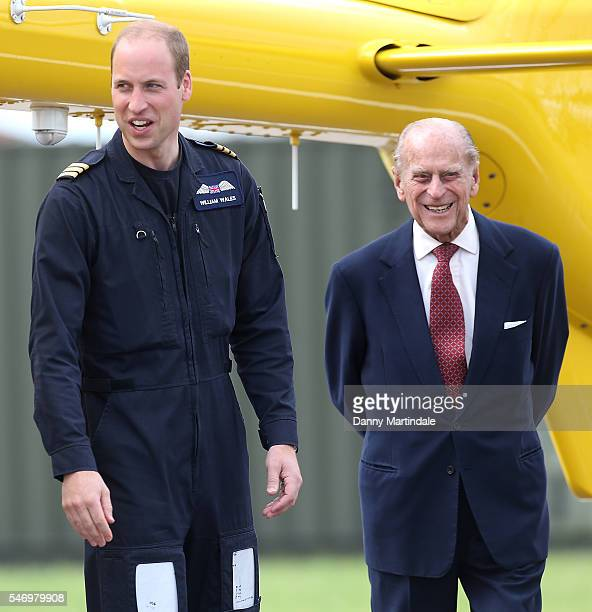 Prince William Duke of Cambridge jokes with Prince Philip Duke of Edinburgh as he says goodbye after visiting the new East Anglian Air Ambulance Base...