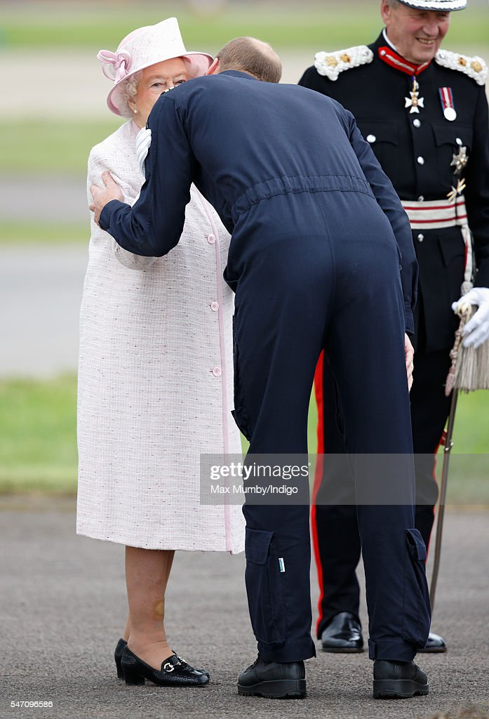 Prince William, Duke of Cambridge kisses his grandmother Queen Elizabeth II goodbye after she opened the new East Anglian Air Ambulance base at Cambridge Airport on July 13, 2016 in Cambridge, England.