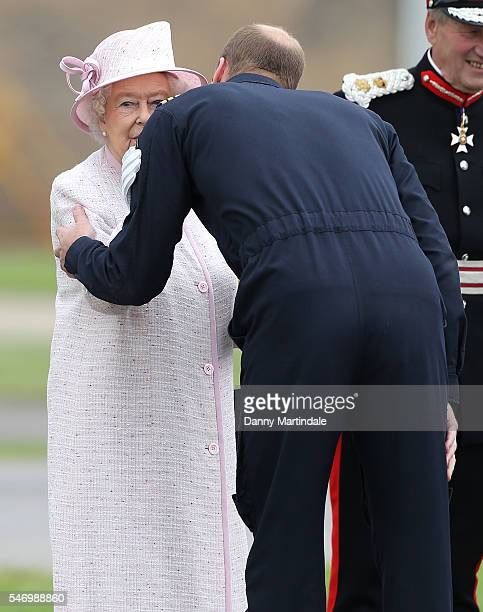 Prince William Duke of Cambridge kisses Queen Elizabeth II as he says goodbye after visiting the new East Anglian Air Ambulance Base at Cambridge...