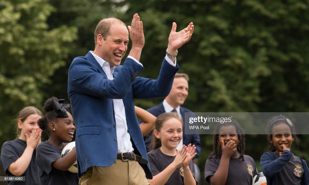 Prince William, Duke of Cambridge laughs and applauds as he attends a kick-about with the Lionesses and local girls team from the Wildcats Girl' Football programme on July 13, 2017 in London, England.