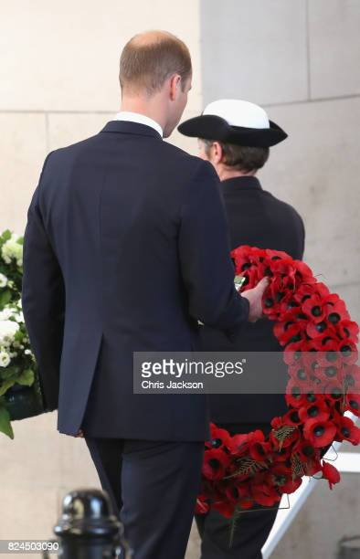 Prince William Duke of Cambridge lays a wreath during the Last Post ceremony which has taken place every night since 1928 at the Commonwealth War...