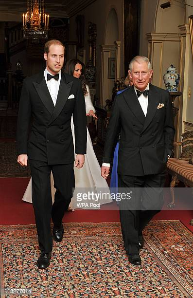 Prince William Duke of Cambridge leaves Clarence House with his father Prince Charles Prince of Wales to travel to Buckingham Palace for the evening...