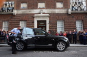 Prince William Duke of Cambridge leaves the Lindo Wing of St Mary's Hospital with his newborn son on July 23 2013 in London England The Duchess of...