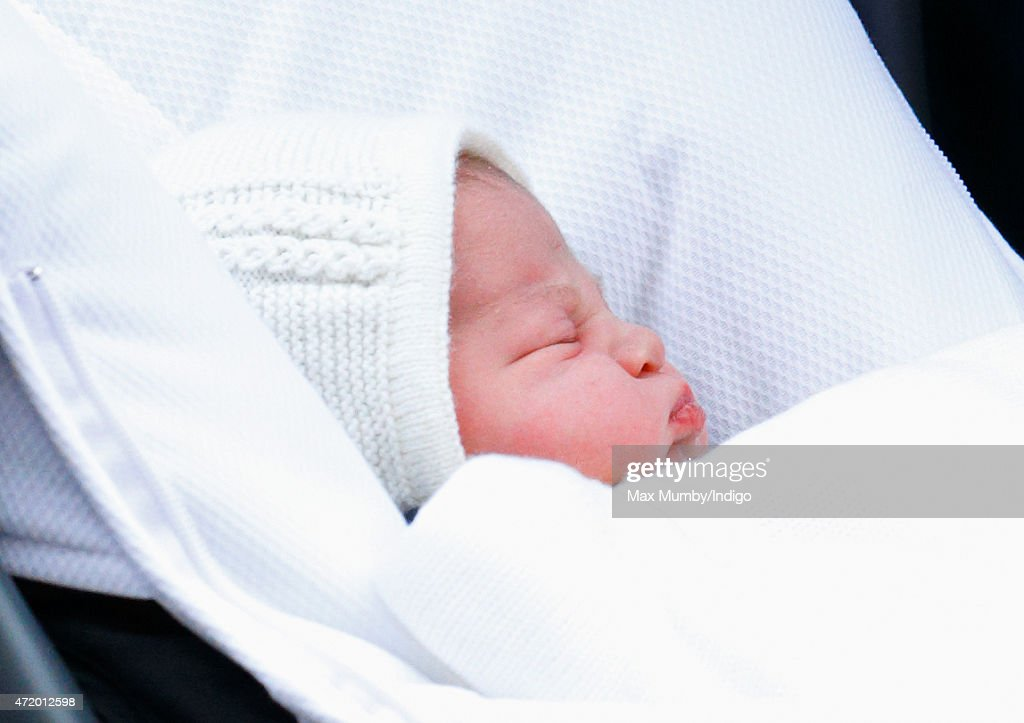 Prince William Duke of Cambridge leaves the Lindo Wing with his newborn daughter at St Mary's Hospital on May 2 2015 in London England The Duchess...