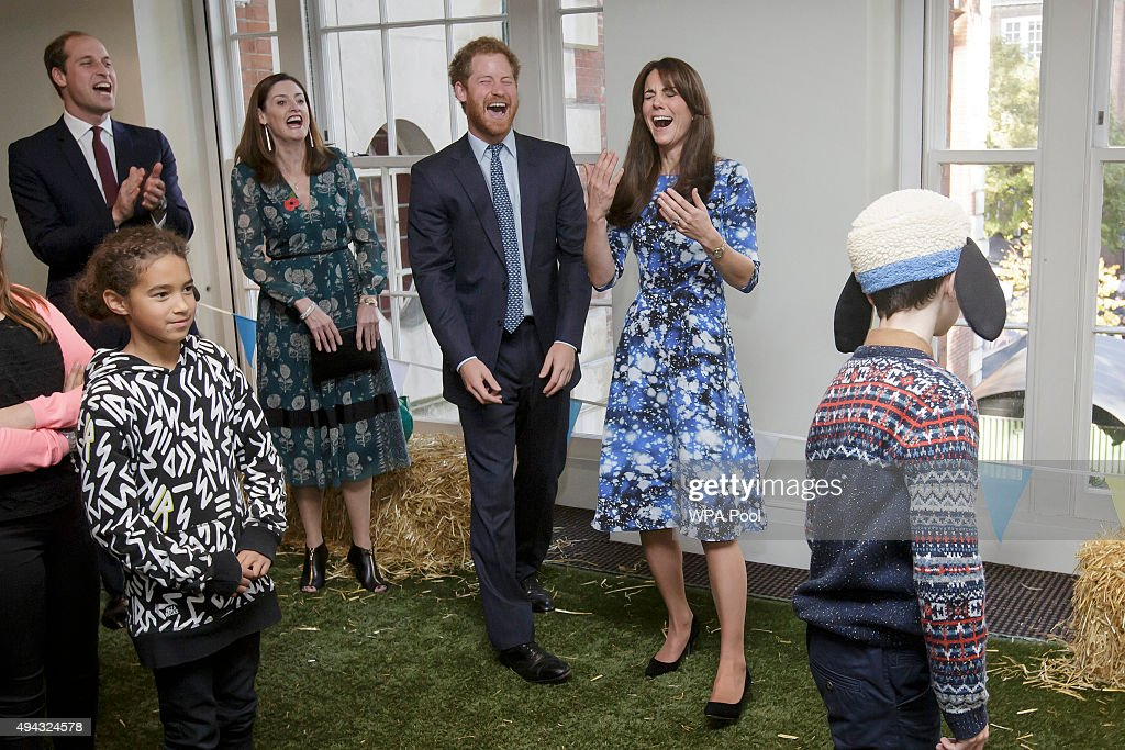 Prince William, Duke of Cambridge, left, Prince Harry, centre, and Catherine, Duchess of Cambridge, right, smile as they take part in 'welly wanging', with children and representatives from charities and Aardman Animations, during a meeting of the Charities Forum at BAFTA on October 26, 2015 in London, United Kingdom.