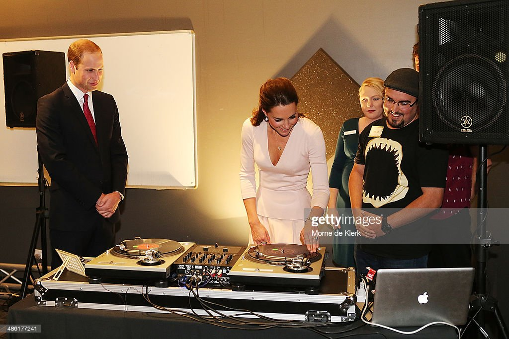 Prince William, Duke of Cambridge, looks on as Catherine, Duchess of Cambridge is shown how to play on DJ decks at the youth community centre, The Northern Sound System in Elizabeth on April 23, 2014 in Adelaide, Australia. The Duke and Duchess of Cambridge are on a three-week tour of Australia and New Zealand, the first official trip overseas with their son, Prince George of Cambridge.