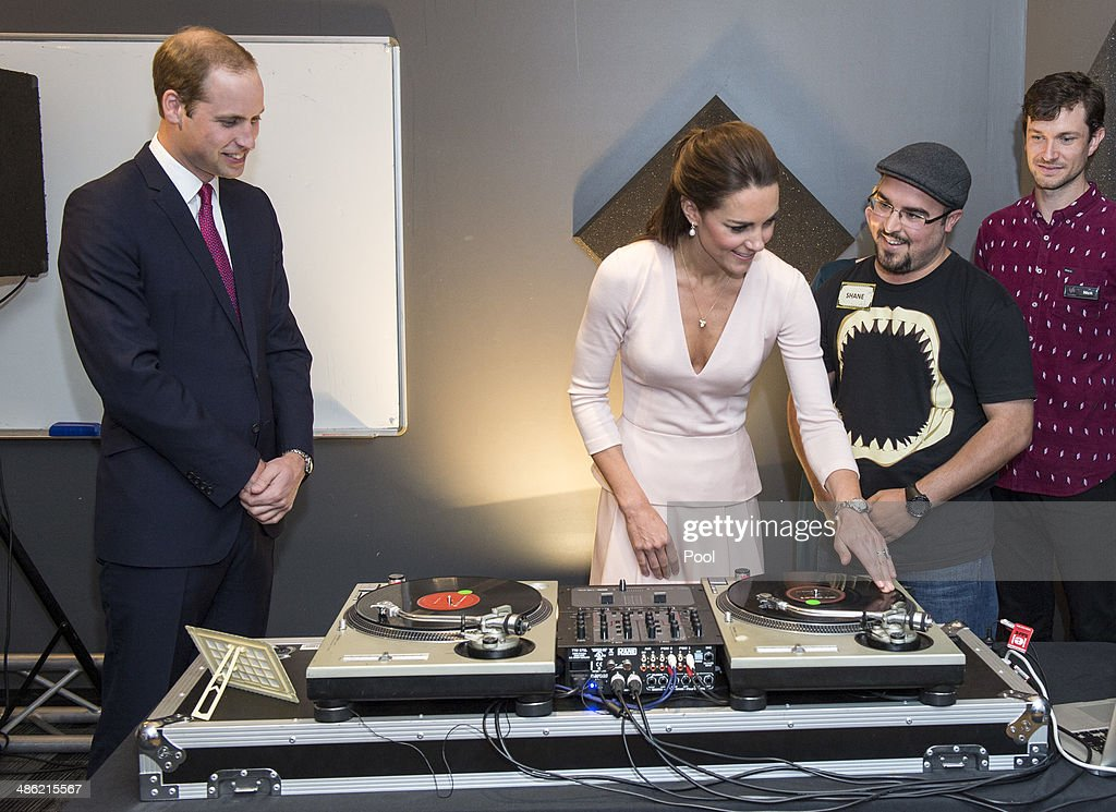 Prince William, Duke of Cambridge looks on as Catherine, Duchess of Cambridge is shown how to play on DJ decks at the youth community centre, The Northern Sound System in Elizabeth on April 23, 2014 in Adelaide, Australia. The Duke and Duchess of Cambridge are on a three-week tour of Australia and New Zealand, the first official trip overseas with their son, Prince George of Cambridge.