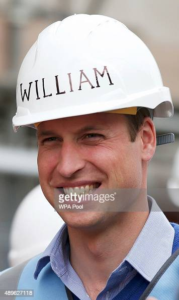 Prince William Duke of Cambridge looks on as he helps to renovate homes for exservice personnel as part of the BBC television DIY SOS series on...