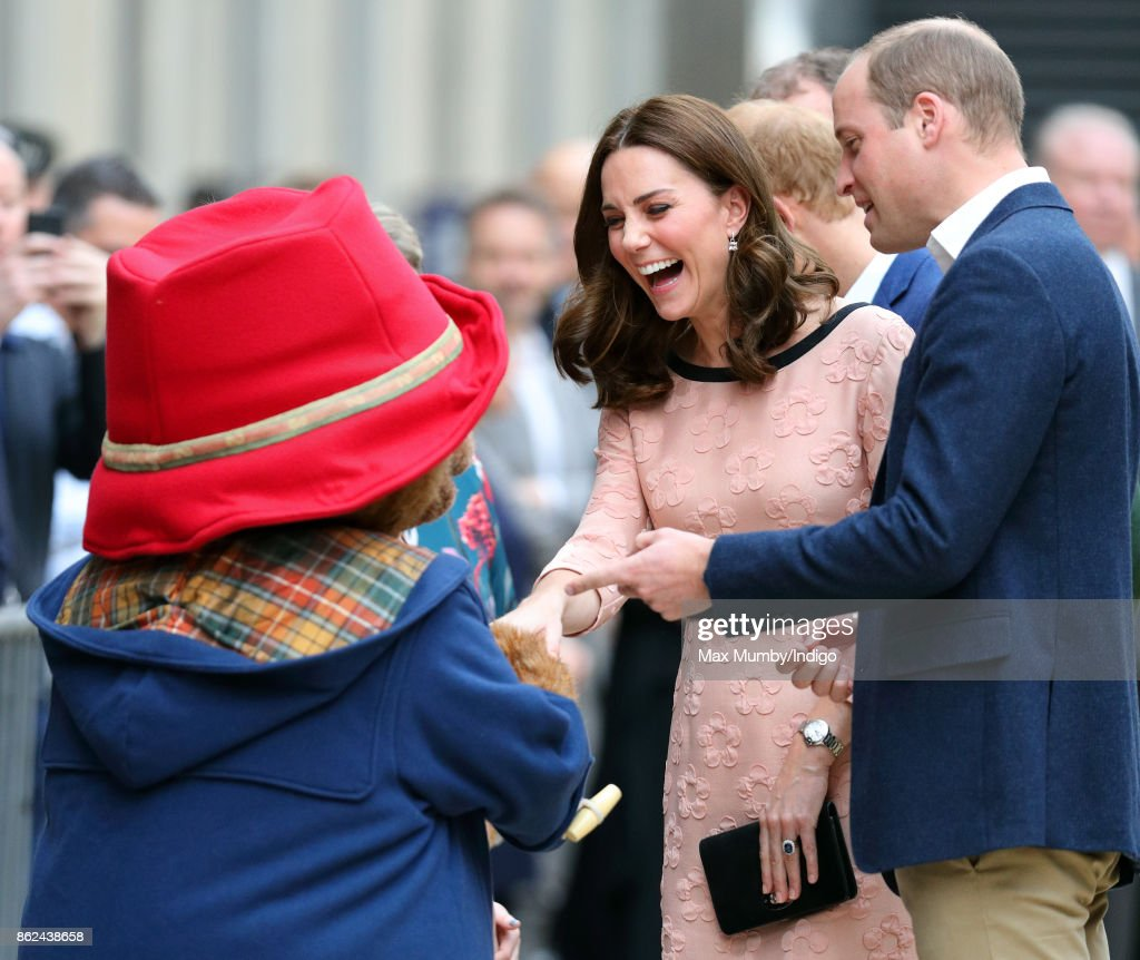 Prince William, Duke of Cambridge looks on as Paddington Bear greets Catherine, Duchess of Cambridge whilst they attend the Charities Forum Event at Paddington Station on October 16, 2017 in London, England.
