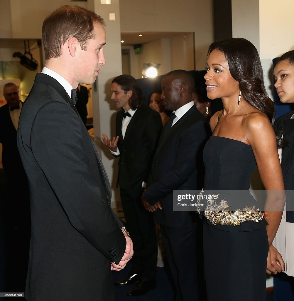 Prince William, Duke of Cambridge meets actress Naomie Harris as they attends the Royal film performance of 'Mandela: Long Walk to Freedom' at Odeon Leicester Square on December 5, 2013 in London, England.