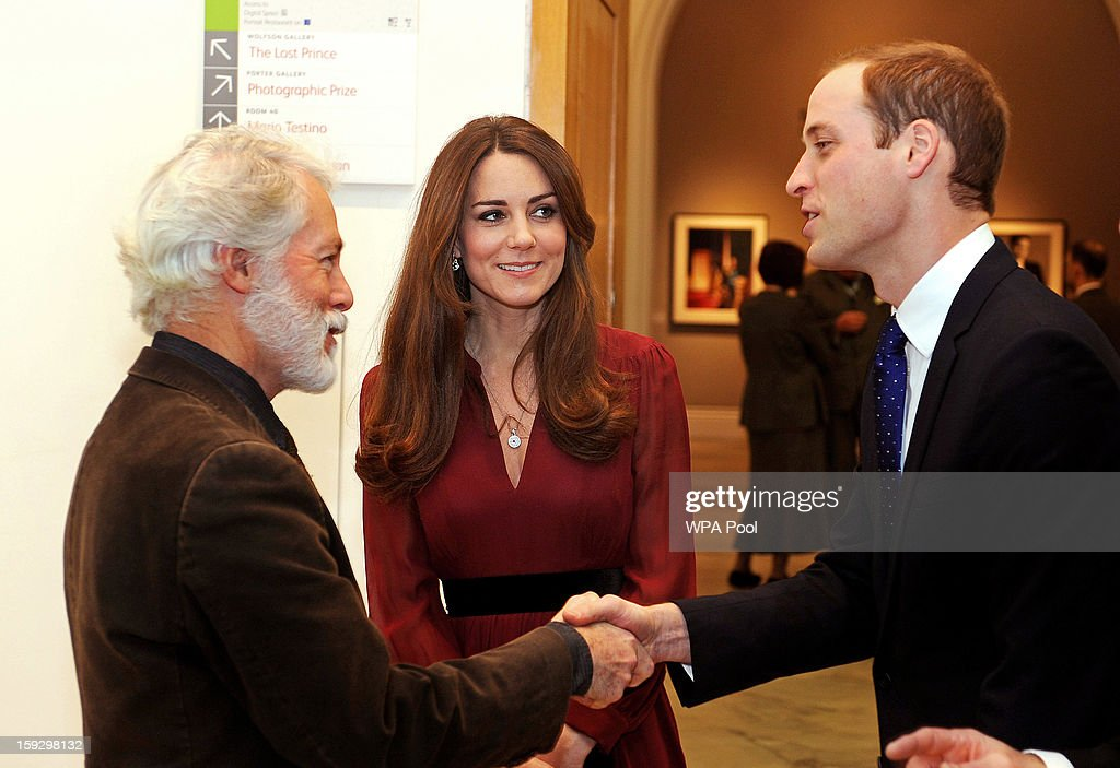 Prince William, Duke of Cambridge meets artist Paul Emsley as <a gi-track='captionPersonalityLinkClicked' href=/galleries/search?phrase=Catherine+-+Hertiginna+av+Cambridge&family=editorial&specificpeople=542588 ng-click='$event.stopPropagation()'>Catherine</a>, Duchess of Cambridge looks on after viewing his new portrait of the Duchess during a private viewing at the National Portrait Gallery on January 11, 2013 in London, England.