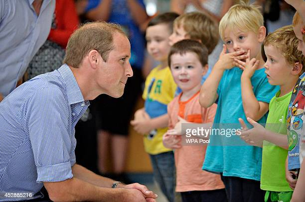 Prince William Duke of Cambridge meets children from Bridgend nursery during a visit to the Coach Core project at Gorbals Leisure Centre on July 29...