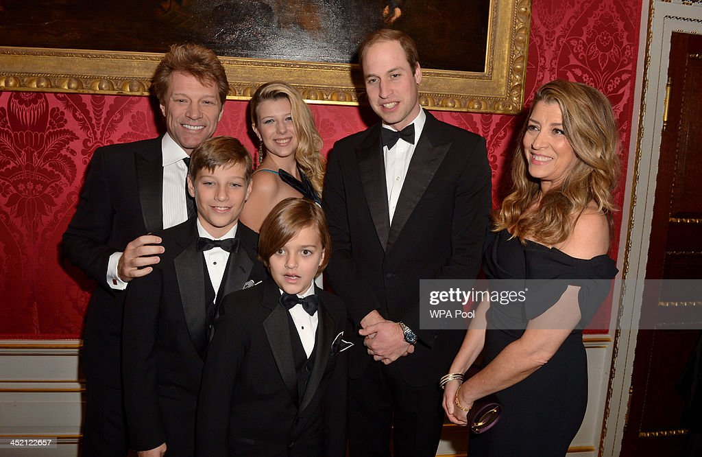 Prince William, Duke of Cambridge meets Jon Bon Jovi (L) and wife Dorothea Hurley (R) and their children Jacob (2L), Stephanie (3L) and Romeo (front, 4L) at Kensington Palace for the Centrepoint Winter Whites Gala on November 26, 2013 in London, England.