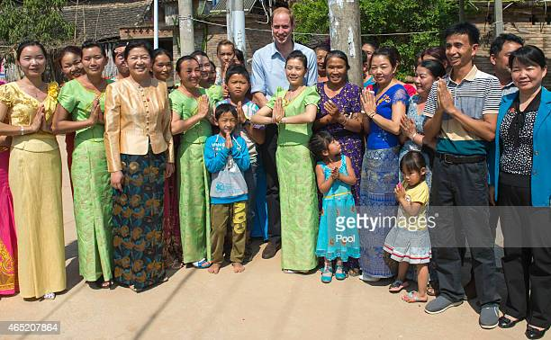 Prince William Duke of Cambridge meets locals as he visits Mengman village on March 4 2015 in Xishuangbanna China Prince William Duke of Cambridge is...
