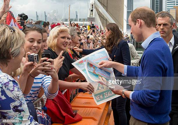 Prince William Duke of Cambridge meets members of the public at Auckland Harbour in the rain on April 11 2014 in Auckland New Zealand The Duke and...