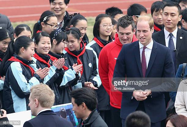 Prince William Duke of Cambridge meets school children as he attends a Premier Skills Football Event on March 3 2015 in Shanghai China Prince William...