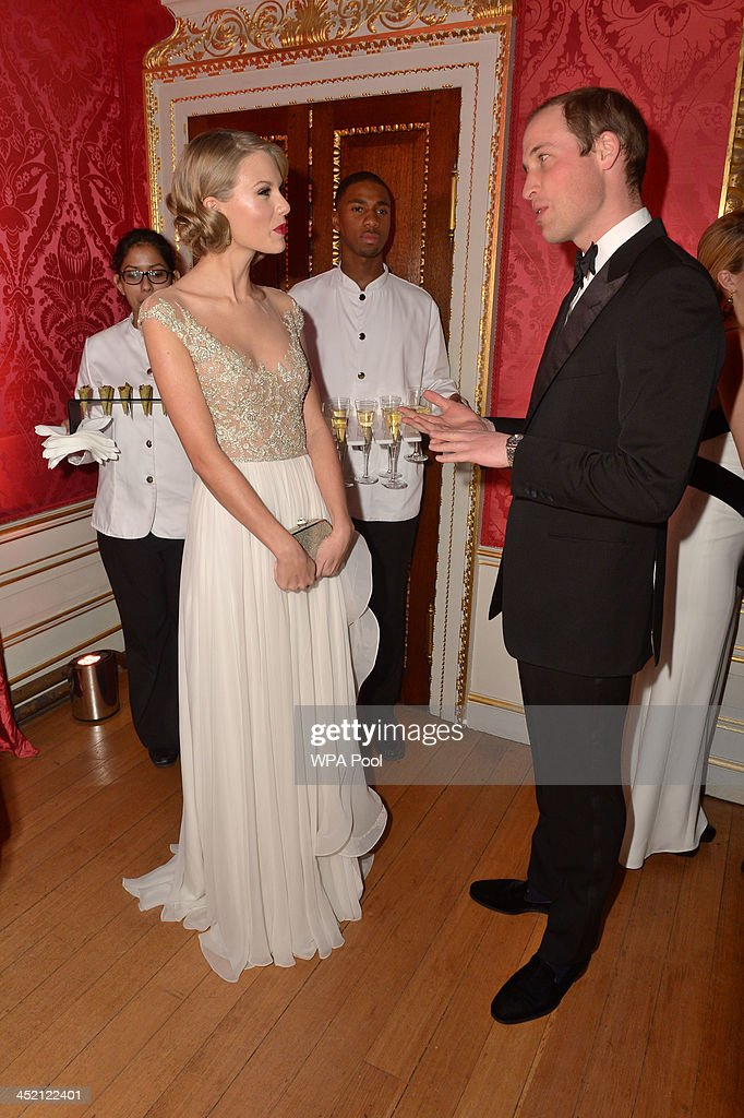 Prince William, Duke of Cambridge meets singer Taylor Swift at Kensington Palace for the Centrepoint Winter Whites Gala on November 26, 2013 in London, England.
