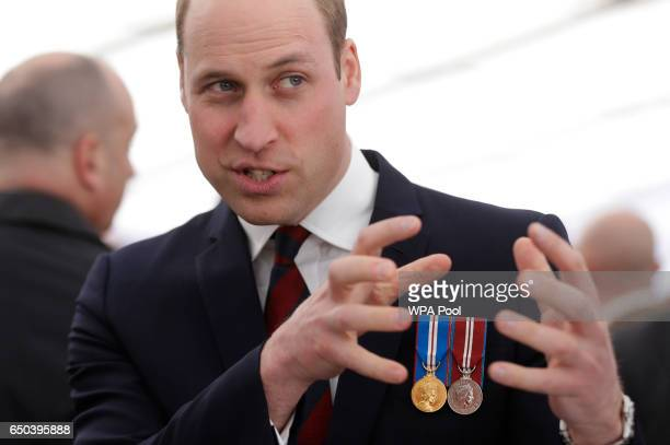 Prince William Duke of Cambridge meets veterans and serving members of the British armed forces at a reception following the unveiling of the new...
