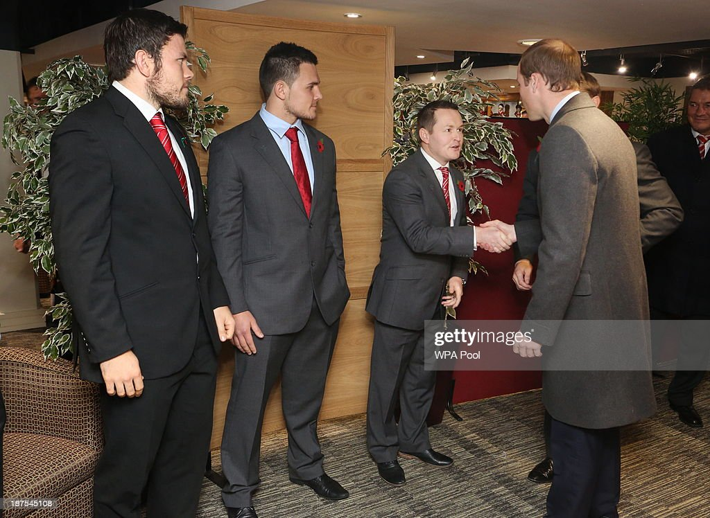 Prince William, Duke of Cambridge (2nd R) meets (L-R) Wales 7's captain Adam Thomas, Wales U20's captain Ellis Jenkins and Gethin Watts in the International Player's Lounge after the Autumn International between Wales and South Africa at the Millennium Stadium on November 9, 2013 in Cardiff, Wales.