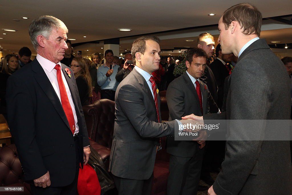 Prince William, Duke of Cambridge (2nd R) meets (L-R) Wales U18 Head Coach Allan Lewis and WRU Women's rugby coach Rhys Edwards in the International Player's Lounge after the Autumn International between Wales and South Africa at the Millennium Stadium on November 9, 2013 in Cardiff, Wales.