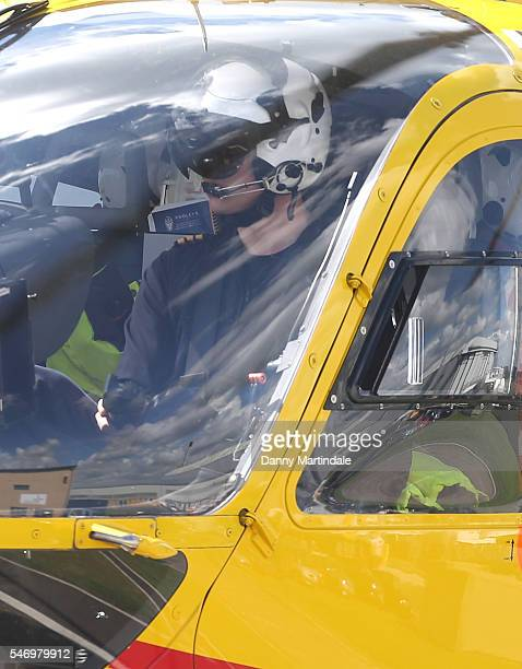 Prince William Duke of Cambridge pilots his air ambulance as he arrives back at the new East Anglian Air Ambulance Base after a callout at Cambridge...