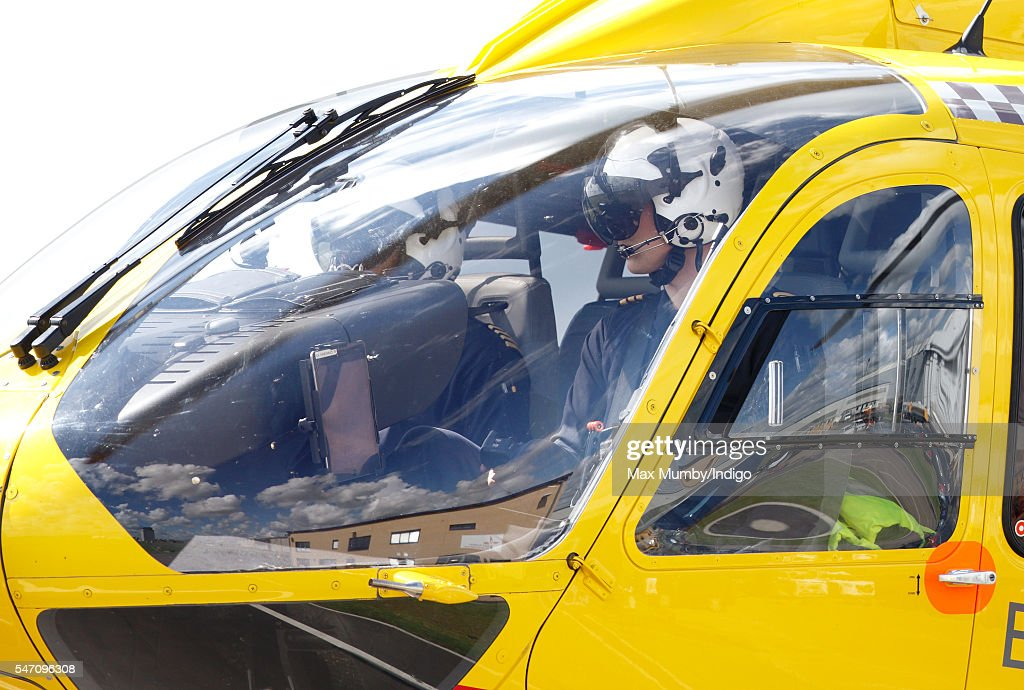 Prince William, Duke of Cambridge pilots his air ambulance into land at the East Anglian Air Ambulance base at Cambridge Airport on July 13, 2016 in Cambridge, England.