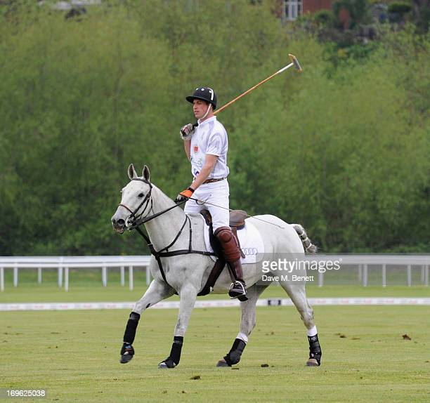 Prince William Duke of Cambridge playing polo at the Audi Royal Polo Challenge 2013 at Chester Racecourse on May 29 2013 in Chester England